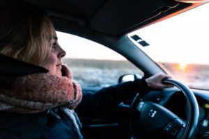 woman driving car in winter weather