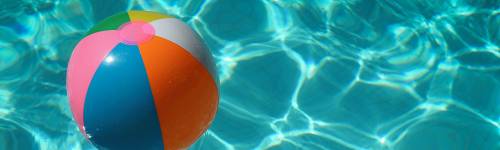 colorful beach ball floats on pool