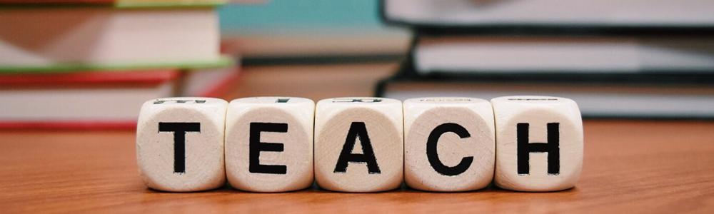 letter blocks spell out teach